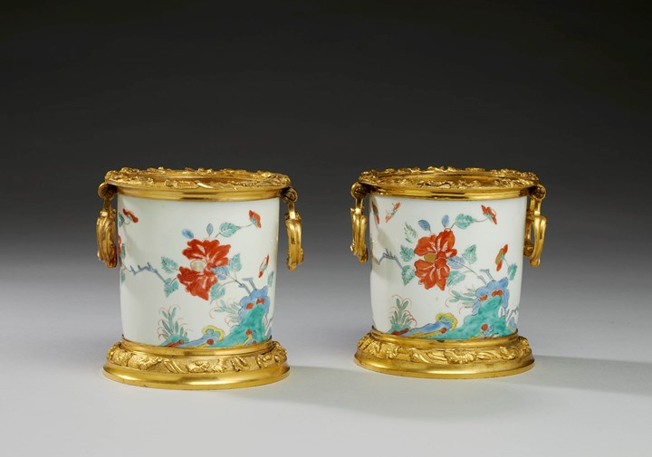 A pair of ormolu mounted cache-pots  with Kakiemon decoration